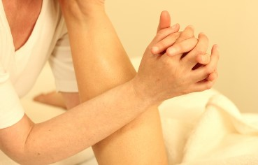 client receiving arm muscle massage